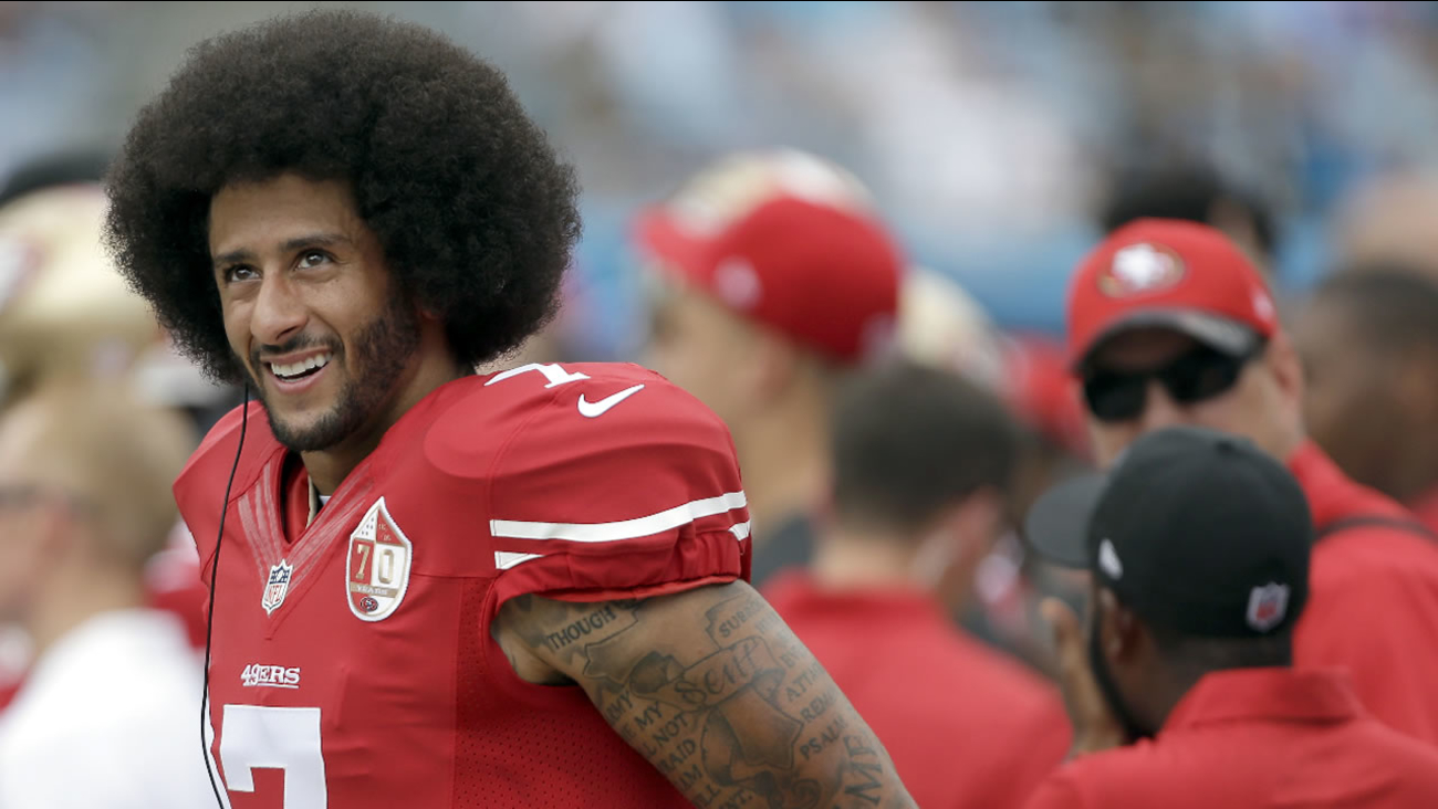 49ers' Colin Kaepernick on the sidelines during the first half of an NFL football game against the Carolina Panthers in Charlotte, N.C., Sunday, Sept. 18, 2016.