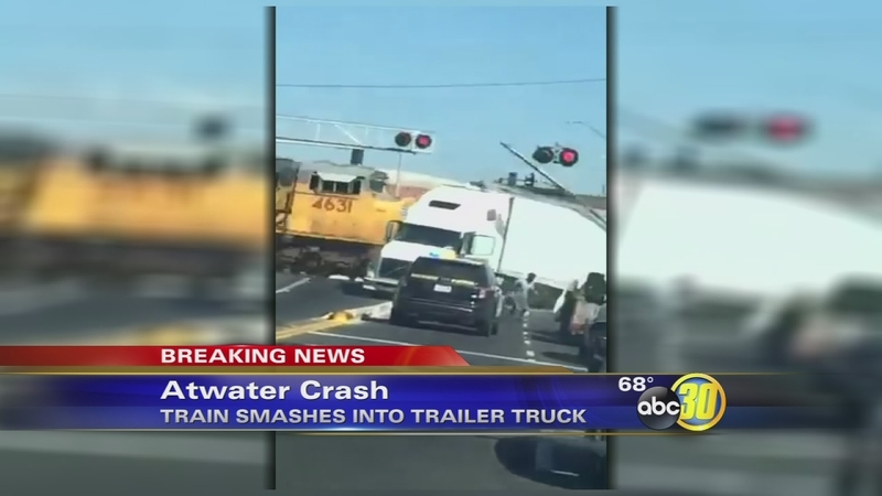 Train smashes into semi-truck stuck on tracks in Atwater