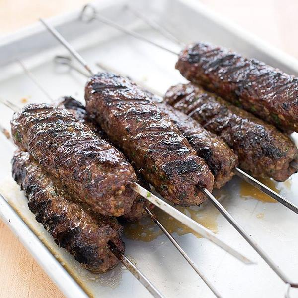 "<div class=""meta image-caption""><div class=""origin-logo origin-image none""><span>none</span></div><span class=""caption-text"">Lamb Kafta Kabob from Neomade across from the State Fair Flyer in Kiddieland (Credit: N.C. State Fair)</span></div>"