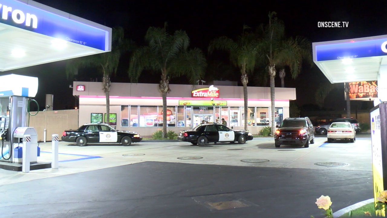 "Authorities surrounded a Chevron gas station in Stanton after a man was suspected of ""casing"" it for a possible robbery on Wednesday, Oct. 12, 2016."