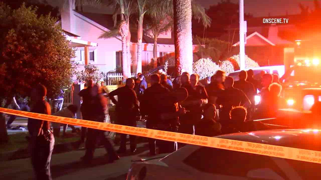 Police and groups of people surround the scene of a house party shooting in West Los Angeles early Saturday, Oct. 15, 2016.