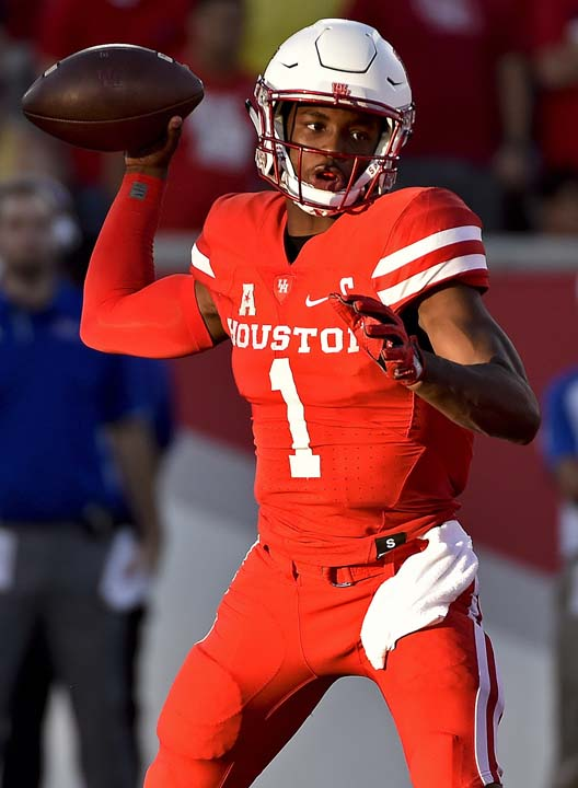 <div class='meta'><div class='origin-logo' data-origin='AP'></div><span class='caption-text' data-credit='Eric Christian Smith'>Houston quarterback Greg Ward Jr. drops back to pass in the first half of an NCAA college football game against Tulsa, Saturday, Oct. 15, 2016, in Houston.</span></div>