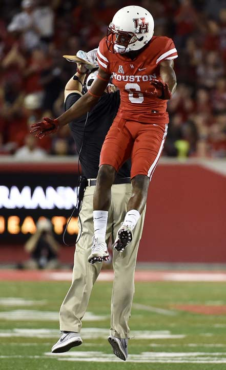 <div class='meta'><div class='origin-logo' data-origin='AP'></div><span class='caption-text' data-credit='Eric Christian Smith'>Houston cornerback Howard Wilson, right, celebrates his interception with head coach Tom Herman in the first half.</span></div>