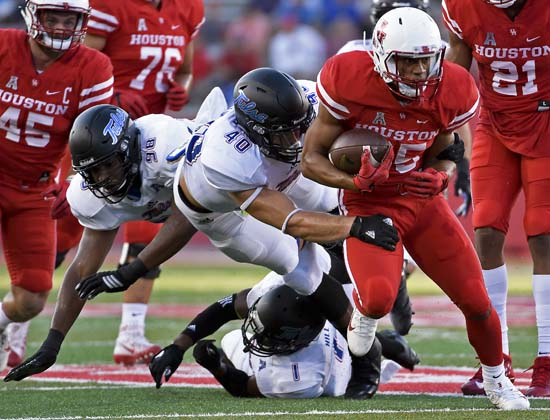 <div class='meta'><div class='origin-logo' data-origin='AP'></div><span class='caption-text' data-credit='Eric Christian Smith'>Houston running back Dillon Birden, right, escapes the tackle of Tulsa linebacker Trent Martin (40) in the first half.</span></div>