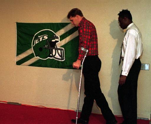"<div class=""meta image-caption""><div class=""origin-logo origin-image ap""><span>AP</span></div><span class=""caption-text"">New York Jets defensive end Dennis Byrd, paralyzed in a collision with a teammate the season before, walks to his place at a New York news conference in February 1993. (AP)</span></div>"