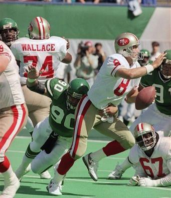 "<div class=""meta image-caption""><div class=""origin-logo origin-image ap""><span>AP</span></div><span class=""caption-text"">New York Jets defensive end Dennis Byrd puts the pressure on San Francisco 49er quarterback Steve Young as he looks for open man down field in the first quarter game, Sept 20, 1992 (AP)</span></div>"