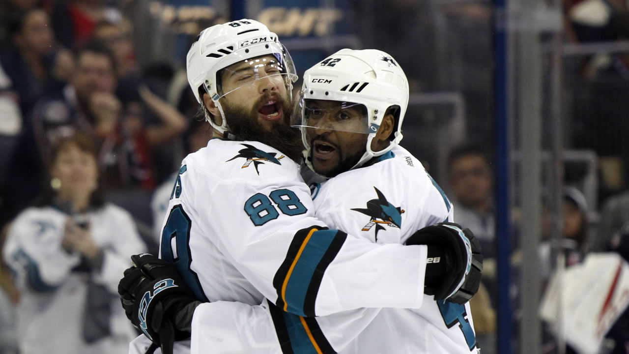San Jose Sharks forward Joel Ward, right, celebrates his goal against the Columbus Blue Jackets with teammate defenseman Brent Burns during the first period of an NHL hockey game.
