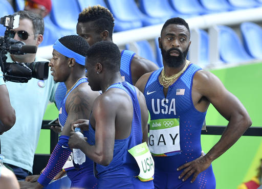 <div class='meta'><div class='origin-logo' data-origin='AP'></div><span class='caption-text' data-credit='AP Photo/Martin Meissner'>United States' Tyson Gay, right, after competing in a men's 4x100-meter relay heat during the athletics competitions of the 2016 Summer Olympics.</span></div>