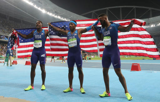 <div class='meta'><div class='origin-logo' data-origin='AP'></div><span class='caption-text' data-credit='AP Photo/Lee Jin-man'>United States' Justin Gatlin, United States' Mike Rodgers and United States' Tyson Gay celebrate after the men's 4x100-meter relay final during the 2016 Summer Olympics</span></div>