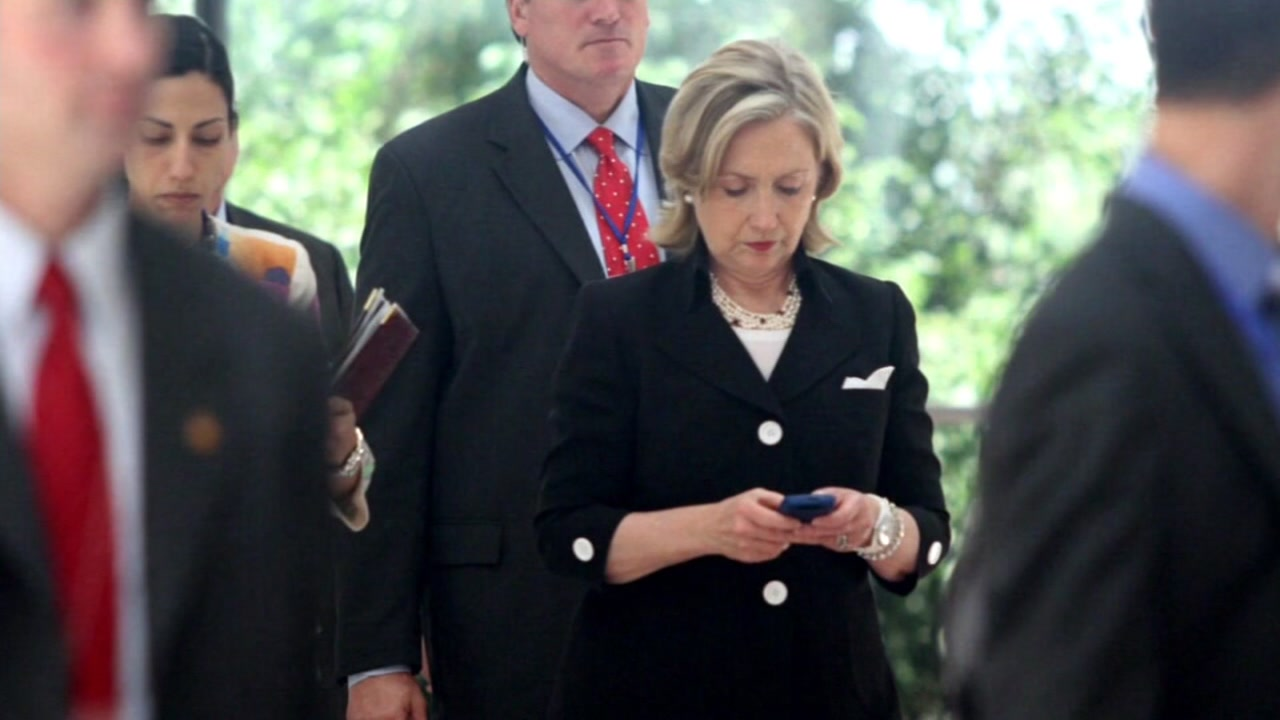 This undated shows Hillary Clinton typing on a cellular phone.