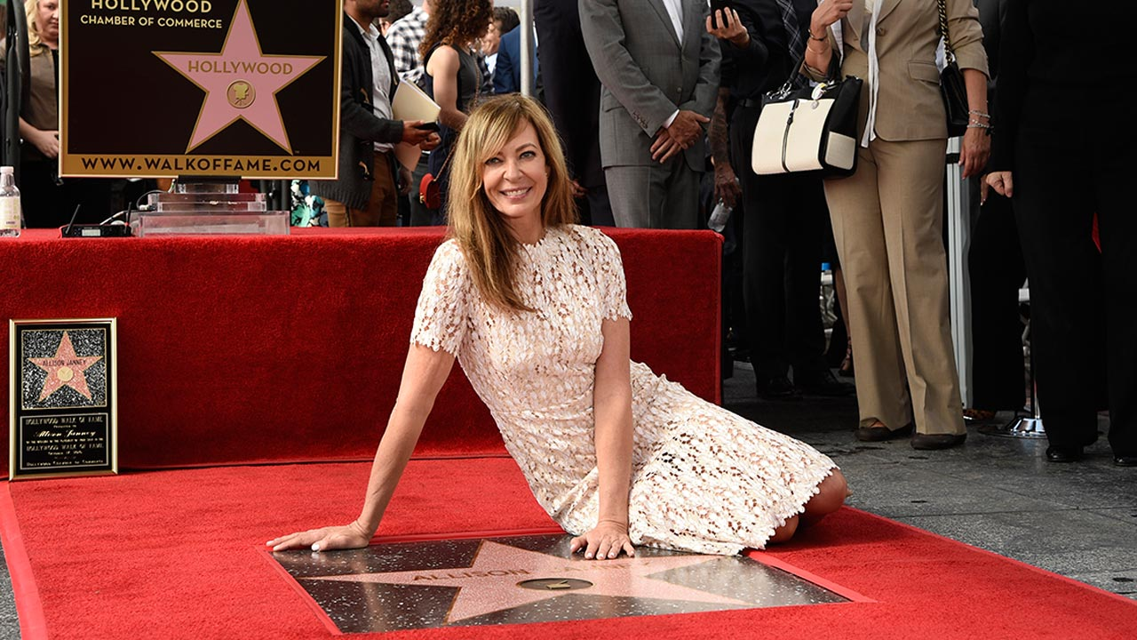 Actress Allison Janney poses atop her new star on the Hollywood Walk of Fame during a ceremony on Monday, Oct. 17, 2016, in Los Angeles.