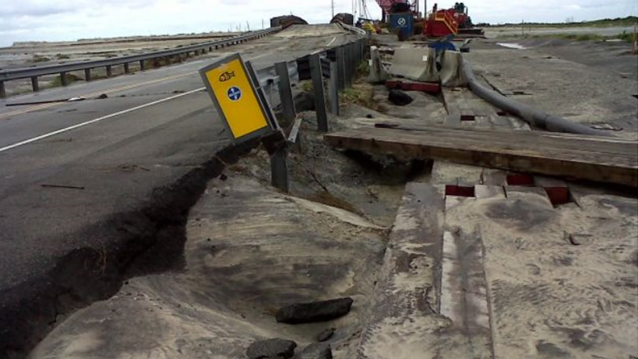 "<div class=""meta image-caption""><div class=""origin-logo origin-image ""><span></span></div><span class=""caption-text"">Damage to Hwy 12 along the Outer Banks caused by Hurricane Arthur (NCDOT Photo)</span></div>"