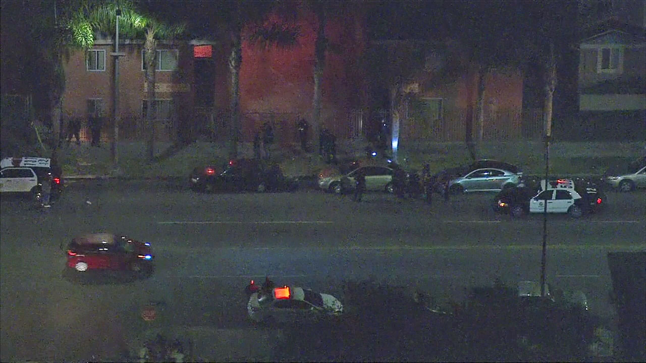 Authorities surrounded an area where two girls were shot and wounded in South Los Angeles on Tuesday, Oct. 18, 2016.