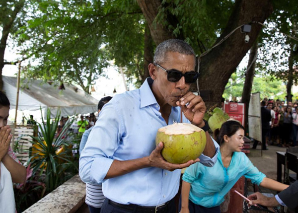 "<div class=""meta image-caption""><div class=""origin-logo origin-image none""><span>none</span></div><span class=""caption-text"">The president enjoying a drink from a coconut in Laos in 2016. (Pete Souza, Chief Official White House Photographer)</span></div>"