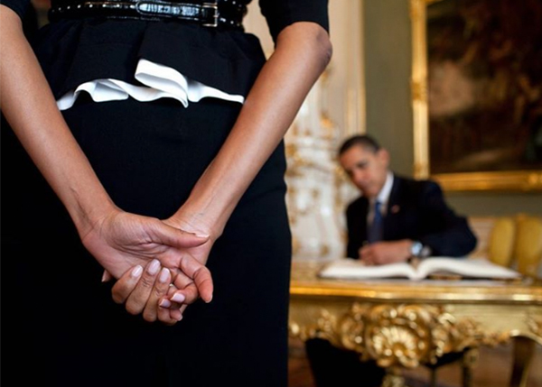 "<div class=""meta image-caption""><div class=""origin-logo origin-image none""><span>none</span></div><span class=""caption-text"">An image of Michelle Obama and Barack Obama at the Prague Castle in 2009, with focus on the first lady's hands as the president signs the castle's guest book. (Pete Souza, Chief Official White House Photographer)</span></div>"