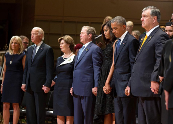 "<div class=""meta image-caption""><div class=""origin-logo origin-image none""><span>none</span></div><span class=""caption-text"">The Obamas with former president George W. Bush, Laura Bush, Vice President Joe Biden and Dr. Jill Biden, at a memorial service to honor fallen police officers in 2016. (Pete Souza, Chief Official White House Photographer)</span></div>"