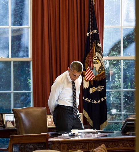 "<div class=""meta image-caption""><div class=""origin-logo origin-image none""><span>none</span></div><span class=""caption-text"">President Obama looking at items on his desk, illuminated by light coming in through the window in 2016. (Pete Souza, Chief Official White House Photographer)</span></div>"