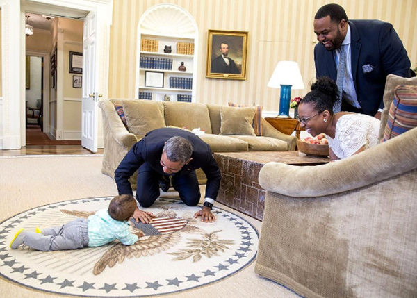 "<div class=""meta image-caption""><div class=""origin-logo origin-image none""><span>none</span></div><span class=""caption-text"">The president gets on all fours to play with the child of a former White House official in the Oval Office in 2016. (Pete Souza, Chief Official White House Photographer)</span></div>"