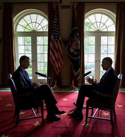 "<div class=""meta image-caption""><div class=""origin-logo origin-image none""><span>none</span></div><span class=""caption-text"">This dimly-lit image shows the president in an interview with Steve Inskeep of NPR in the White House's Cabinet room in 2015. (Pete Souza, Chief Official White House Photographer)</span></div>"