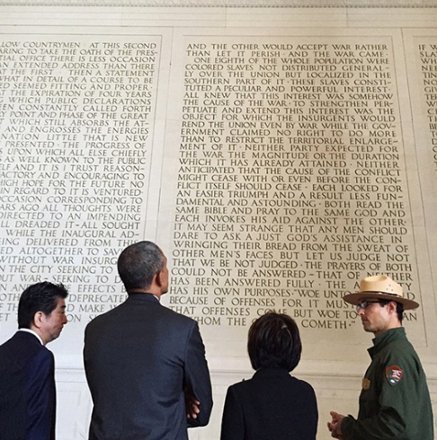 "<div class=""meta image-caption""><div class=""origin-logo origin-image none""><span>none</span></div><span class=""caption-text"">An image of President Obama from behind standing next to Japan's prime minister as they look at President Lincoln's second inaugural address at the Lincoln Memorial in 2015. (Pete Souza, Chief Official White House Photographer)</span></div>"