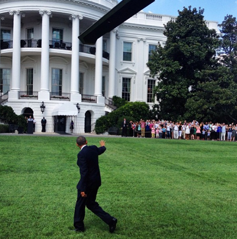 "<div class=""meta image-caption""><div class=""origin-logo origin-image none""><span>none</span></div><span class=""caption-text"">President Obama walking on the South Lawn of the White House while waving at a crowd. (Pete Souza, Chief Official White House Photographer)</span></div>"