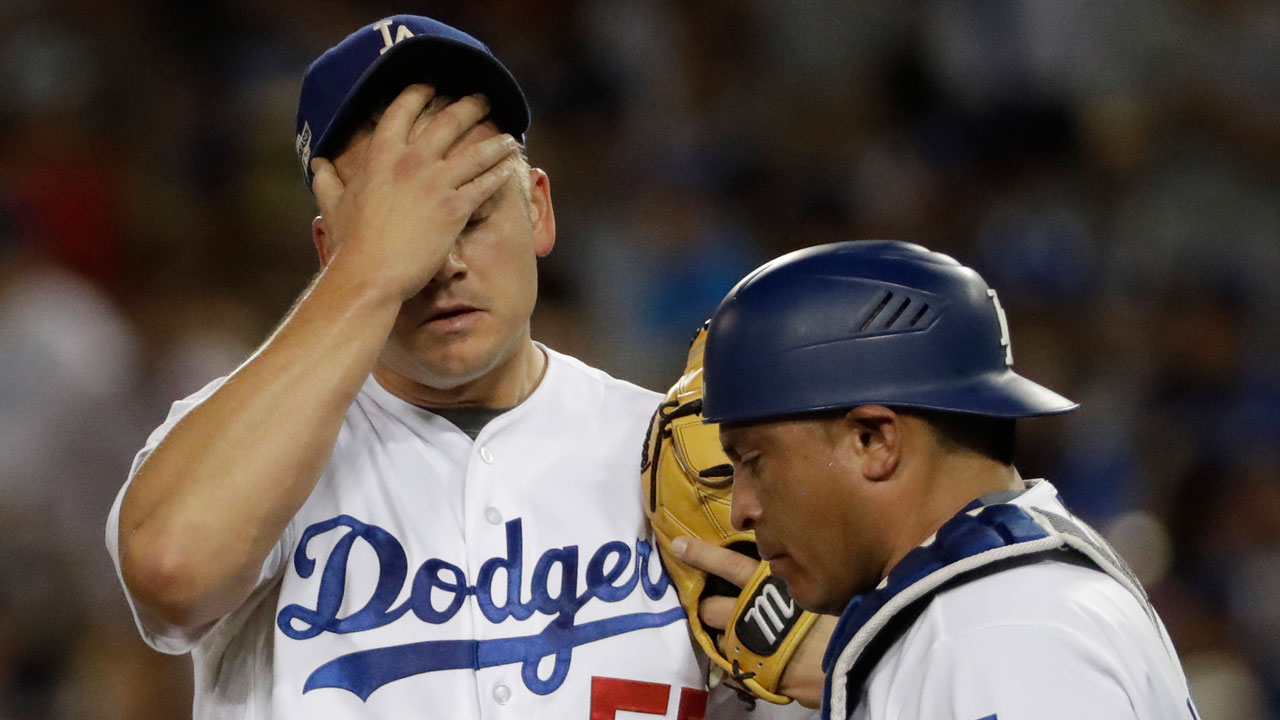 Los Angeles Dodgers' Joe Blanton reacts after giving up a two-run home run to Chicago Cubs' Addison Russell during the sixth inning of Game 5 of the NLCS Thursday, Oct. 20, 2016.
