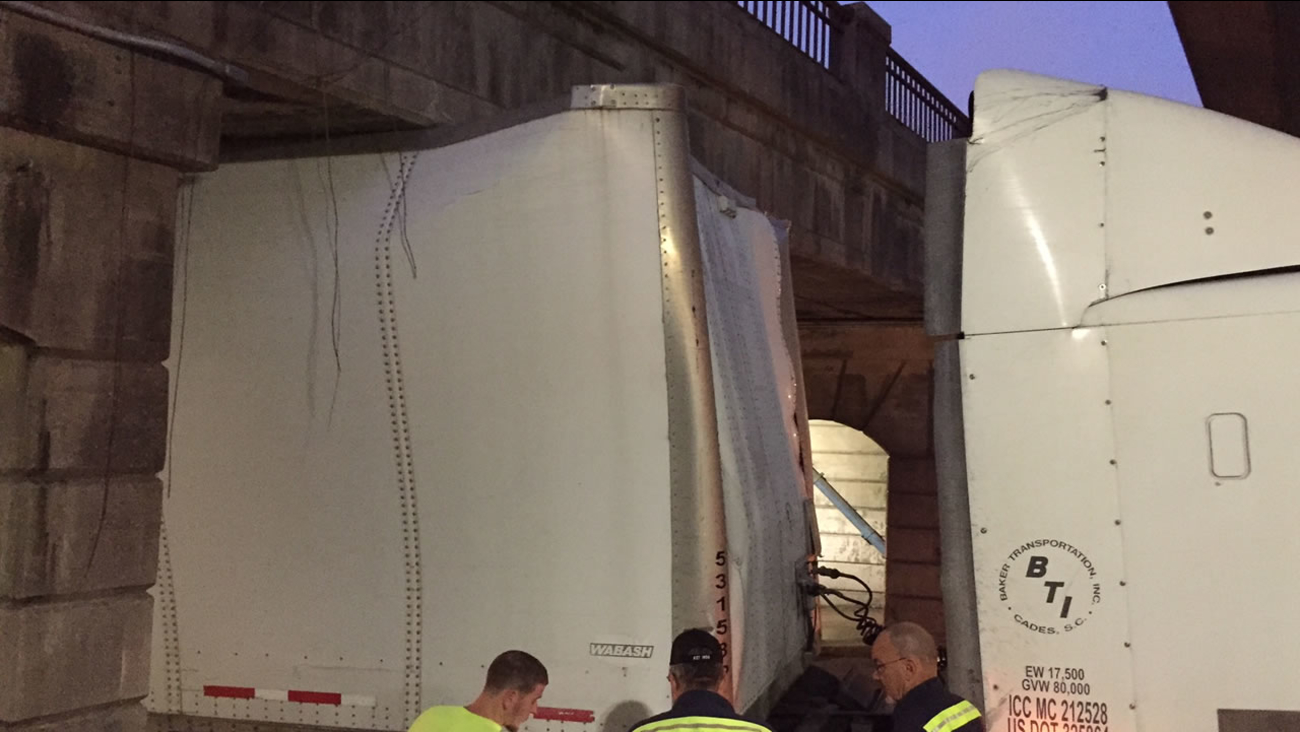 A truck stuck under the Roxboro Street bridge in downtown Durham. (WTVD photo/Jim Schumacher)