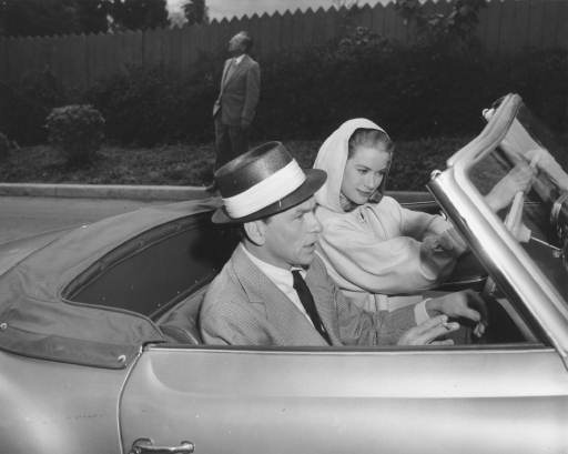 <div class='meta'><div class='origin-logo' data-origin='AP'></div><span class='caption-text' data-credit=''>Grace Kelly and her co-star in &#34;High Society&#34; Frank Sinatra, look back from their Mercedes convertible as they start work Jan. 19 in the Bel-Air section of Los Angeles.</span></div>