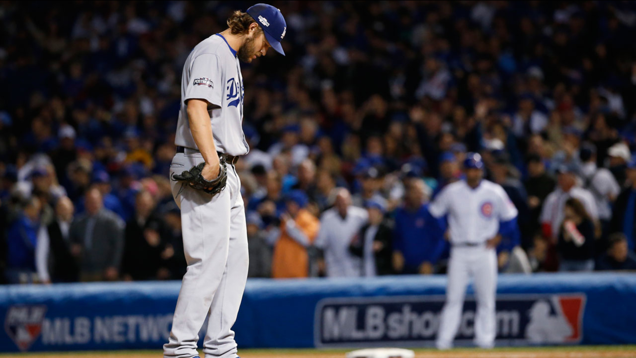 Los Angeles Dodgers starting pitcher Clayton Kershaw looks down as he pitches during Game 6 of the NLCS against the Chicago Cubs, Saturday, Oct. 22, 2016, in Chicago.