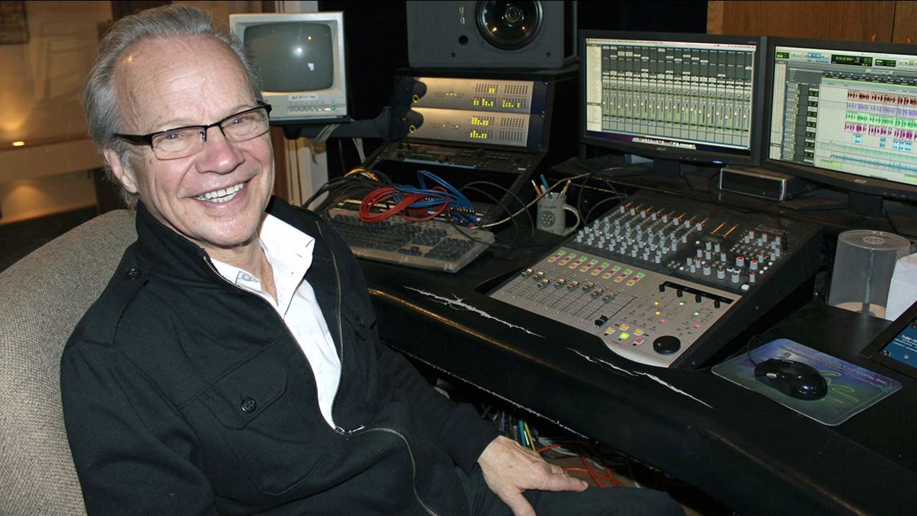 In this photo made Dec. 18, 2013, Bobby Vee poses at his studio console at his family's Rockhouse Productions in St. Joseph, Minnesota.