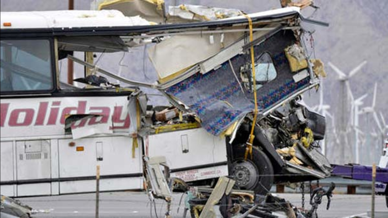 The damaged front of a tour bus is seen that crashed into the back of a semi-truck on Interstate 10 just north of the desert resort town of Palm Springs on Sunday, Oct. 23, 2016.