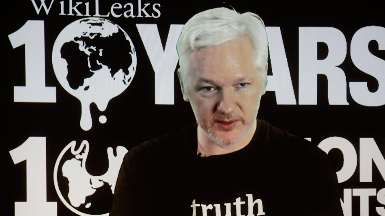WikiLeaks founder Julian Assange participates via video link at a news conference