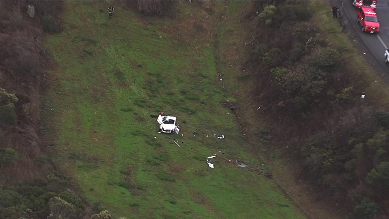 This image shows a car that fell down an embankment in Brisbane, Calif. on Oct. 25, 2016.