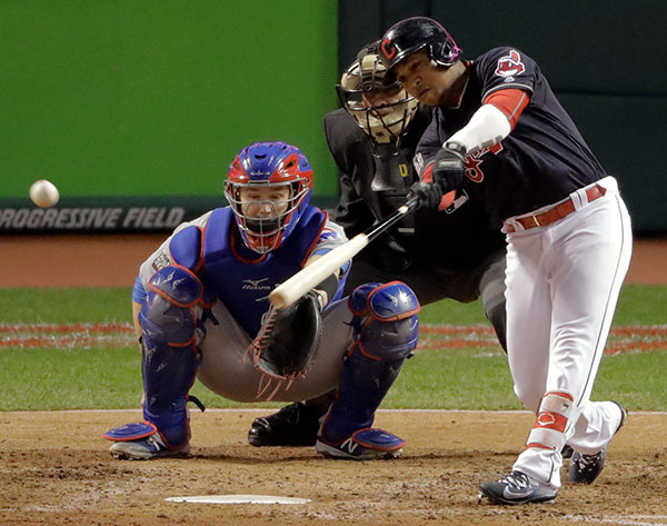 "<div class=""meta image-caption""><div class=""origin-logo origin-image none""><span>none</span></div><span class=""caption-text"">Cleveland Indians' Jose Ramirez hits a RBI single against the Chicago Cubs during the first inning. (AP Photo/Charlie Riedel)</span></div>"