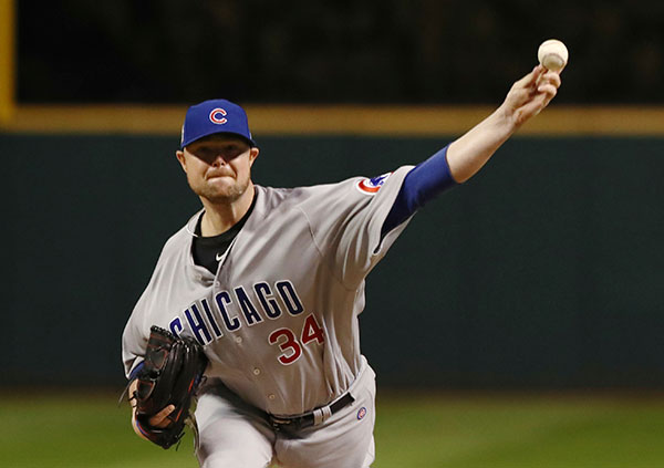 "<div class=""meta image-caption""><div class=""origin-logo origin-image none""><span>none</span></div><span class=""caption-text"">Chicago Cubs starting pitcher Jon Lester throws during the first inning of Game 1. (AP Photo/Elsa Garrison)</span></div>"