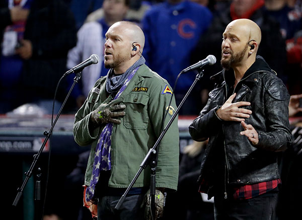 "<div class=""meta image-caption""><div class=""origin-logo origin-image none""><span>none</span></div><span class=""caption-text"">Country music duo, LoCash sings the national anthem before Game 2. (AP Photo/Matt Slocum)</span></div>"