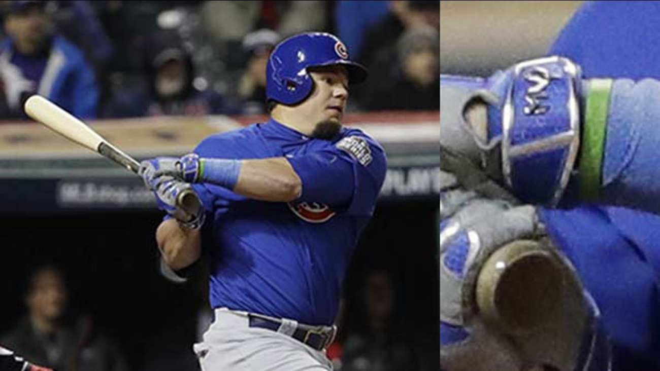 Kyle Schwarber can be seen wearing a green bracelet during Game 2 of the World Series against the Cleveland Indians Wednesday, Oct. 26, 2016.