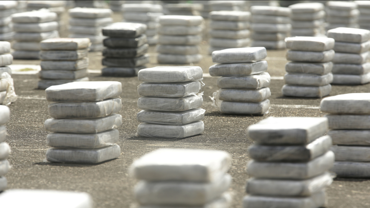 In this Oct. 17, 2016 photo, packages containing cocaine are displayed on the ground before a press conference at a naval base in Panama City. According to authorities.
