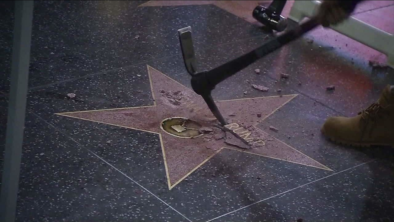 A vandal is seen destroying Donald Trump's star on the Hollywood Walk of Fame.