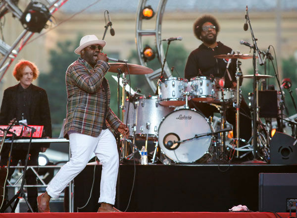 "<div class=""meta image-caption""><div class=""origin-logo origin-image ""><span></span></div><span class=""caption-text"">Black Thought, foreground left, and Questlove, right, of The Roots perform at the Philly Forth of July Jam in Philadelphia on Friday, July 4, 2014. (Photo/Mark Stehle)</span></div>"