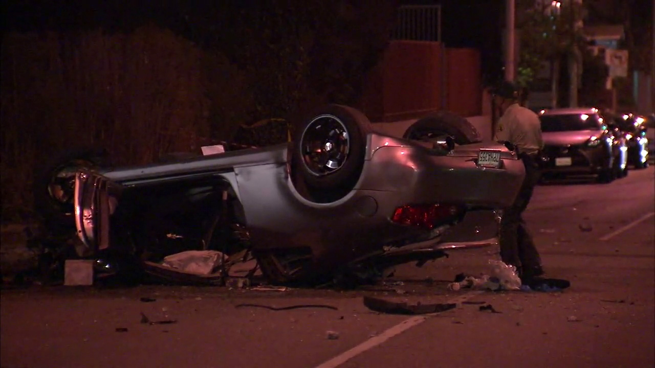 A car overturned in a crash in West Hollywood on Thursday, Oct. 27, 2016, killing one person and leaving three hospitalized.