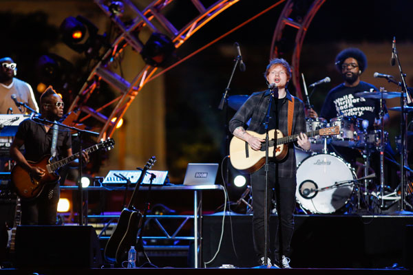"<div class=""meta image-caption""><div class=""origin-logo origin-image ""><span></span></div><span class=""caption-text"">Ed Sheeran performs with the Roots at the Philly 4th of July Jam in Philadelphia on Friday, July 4, 2014. (Photo by Mark Stehle/Invision/AP)</span></div>"