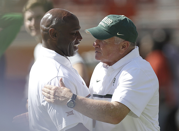 "<div class=""meta image-caption""><div class=""origin-logo origin-image ap""><span>AP</span></div><span class=""caption-text"">Texas head coach Charlie Strong, left, talks with Baylor head coach Jim Grobe, right, before a NCAA college football game, Saturday, Oct. 29, 2016, in Austin, Texas. (AP Photo/Eric Gay)</span></div>"