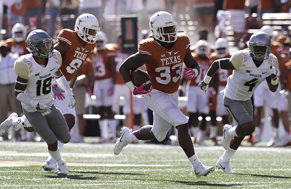 "<div class=""meta image-caption""><div class=""origin-logo origin-image ap""><span>AP</span></div><span class=""caption-text"">Texas running back D'Onta Foreman (33) runs for a 37- yard touchdown against Baylor during the first half on a NCAA college football game, Saturday, Oct. 29, 2016. (AP Photo/Eric Gay)</span></div>"