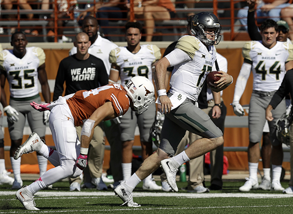 "<div class=""meta image-caption""><div class=""origin-logo origin-image ap""><span>AP</span></div><span class=""caption-text"">Baylor quarterback Seth Russell (17) scores against Texas on a 50-yard run during the first half on a NCAA college football game, Saturday, Oct. 29, 2016. (AP Photo/Eric Gay)</span></div>"