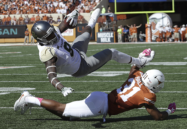 "<div class=""meta image-caption""><div class=""origin-logo origin-image ap""><span>AP</span></div><span class=""caption-text"">Baylor wide receiver Ishmael Zamora (8) is up ended by Texas safety Jason Hall (31) as he scores a touchdown on a 20-yard pass during the first half. (AP Photo/Eric Gay)</span></div>"