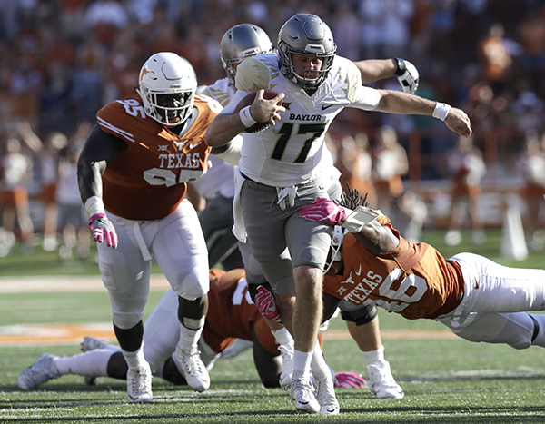 "<div class=""meta image-caption""><div class=""origin-logo origin-image ap""><span>AP</span></div><span class=""caption-text"">Baylor wide receiver Denzel Mims (15) runs past Texas linebacker Malik Jefferson (46) for a first down during the first half on a NCAA college football game. (AP Photo/Eric Gay)</span></div>"