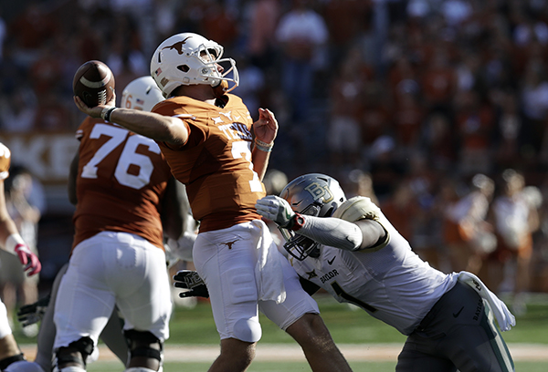 "<div class=""meta image-caption""><div class=""origin-logo origin-image ap""><span>AP</span></div><span class=""caption-text"">Texas quarterback Shane Buechele (7) is pressured by Baylor linebacker Taylor Young (1) during the first half on a NCAA college football game. (AP Photo/Eric Gay)</span></div>"