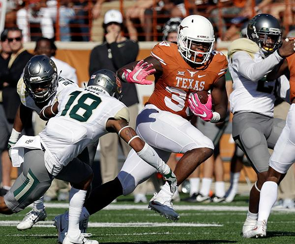 "<div class=""meta image-caption""><div class=""origin-logo origin-image ap""><span>AP</span></div><span class=""caption-text"">Texas running back D'Onta Foreman (33) runs past Baylor safety Chance Waz (18) during the first half on a NCAA college football game. (AP Photo/Eric Gay)</span></div>"
