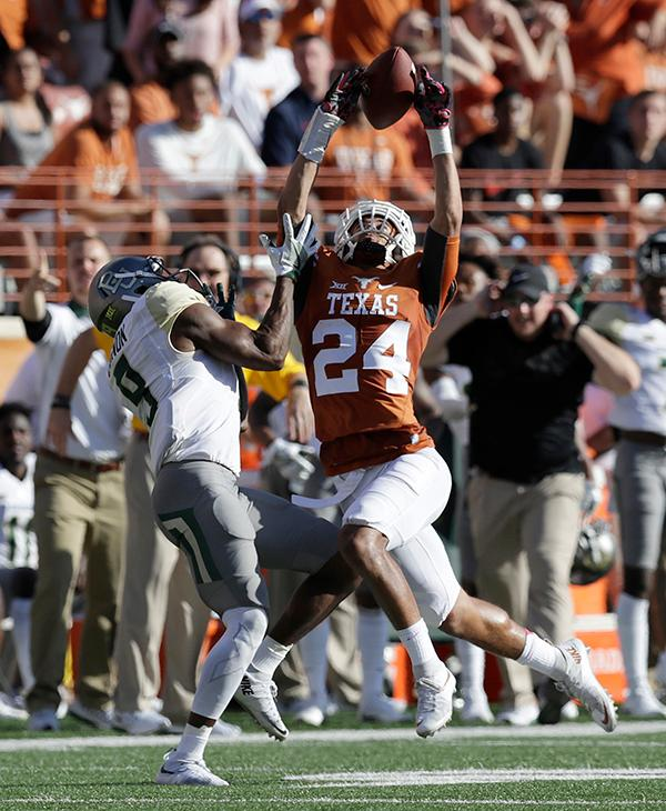 "<div class=""meta image-caption""><div class=""origin-logo origin-image ap""><span>AP</span></div><span class=""caption-text"">Texas cornerback John Bonney (24) breaks up a pass intended for Baylor wide receiver KD Cannon (9) during the first half on a NCAA college football game. (AP Photo/Eric Gay)</span></div>"